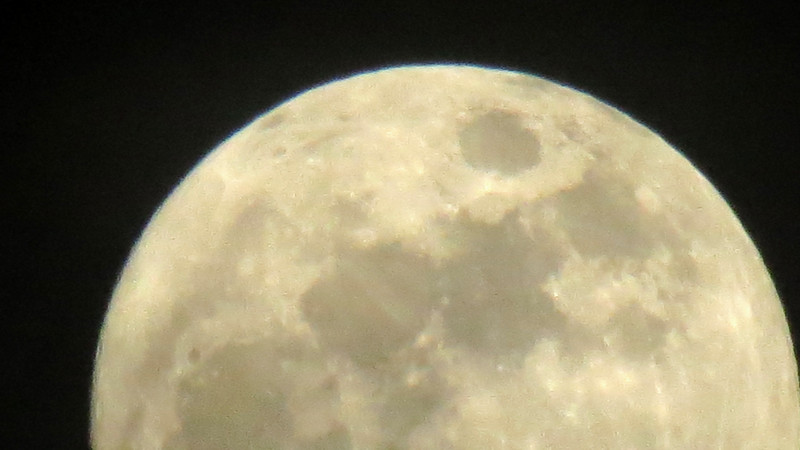 Trying to zoom in on the Christmas full moon.