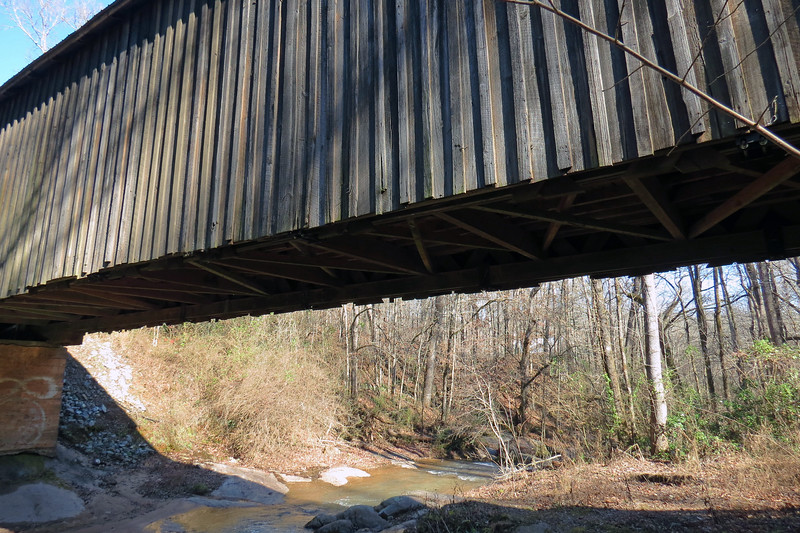 This is one of the few covered bridges in Georgia that carries traffic even though it does not have steel beams supporting the deck.