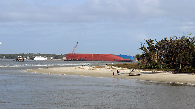 I've always been fascinated by giant cargo ships, and have always enjoyed watching them.  This is the first time I've ever seen one laying on its side.