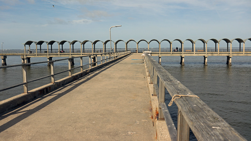 Access to the pier is via a center walkway that splits into two equally large branches.