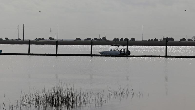 A boat docked at the Jekyll Island Club Marina.