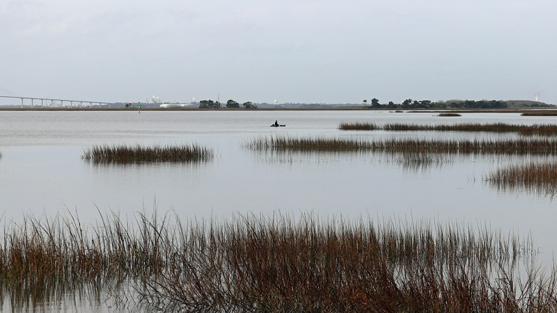 The kayaker is still going strong out on the marsh.