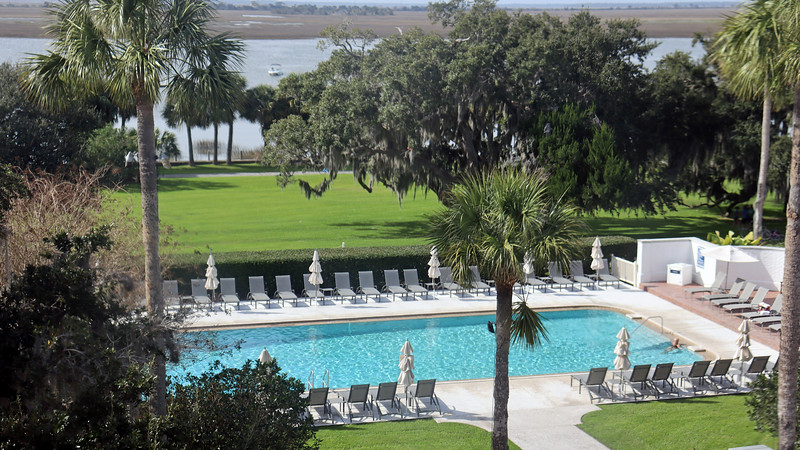 The swimming pool sits across from the large Riverfront Lawn by the wharf.