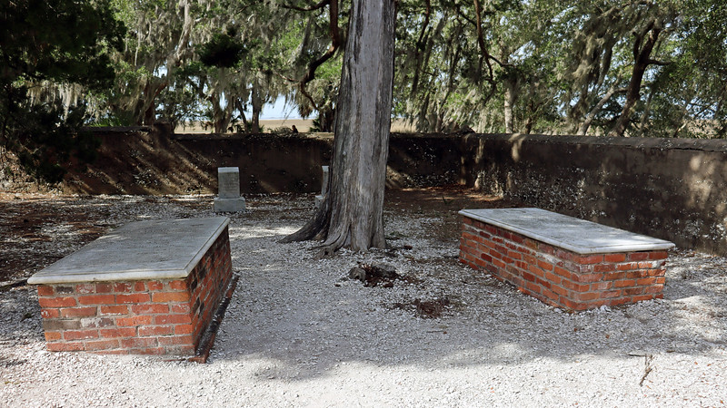 The grave on the far right in the photo above is that of Anne Amelia duBignon, Joseph's mother.  In other words, Joseph is buried in between his mother and mother-in-law.  I can imagine the conversations that would take place in the afterlife !<br /> <br /> The two smaller gravestones in the second row aren't for members of the duBignon family, but for two Jekyll Island Club employees who drowned in the Jekyll River on March 21, 1912.  The left grave is that of Hector DeLiyannis, personal waiter to the J. P. Morgan family.  DeLiyannis drowned while trying to rescue another Club waiter Charles Harvey, who also drowned and is buried in the right grave, (partially obscured by the tree).