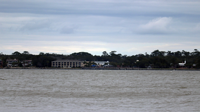 To the left of the lighthouse is the St. Simons Island Pier.