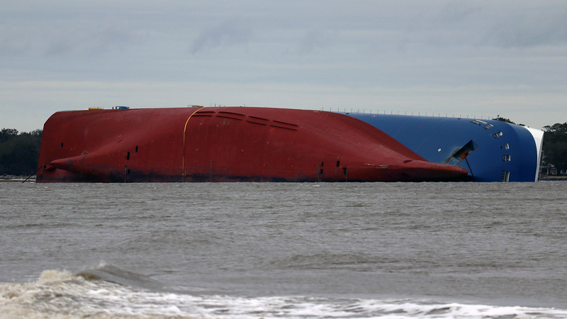 """News stories seem to indicate that the ship suffered some kind of onboard fire.  But other things like """"faulty ballasting"""" and """"cargo shift"""" were also mentioned.  The ship was carrying approximately 4,200 vehicles at the time."""