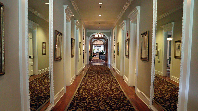 "We're here for brunch today, and headed inside via what I'll call the ""business end"" of the hotel.  The entrance by the valet parking desk takes visitors past a series of meeting rooms via the hallway seen in the photos above and below."