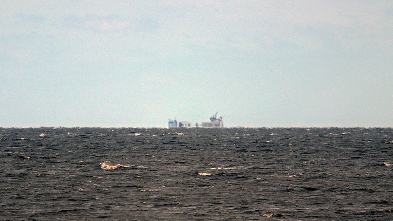 Zooming in on a cargo ship in the distance.