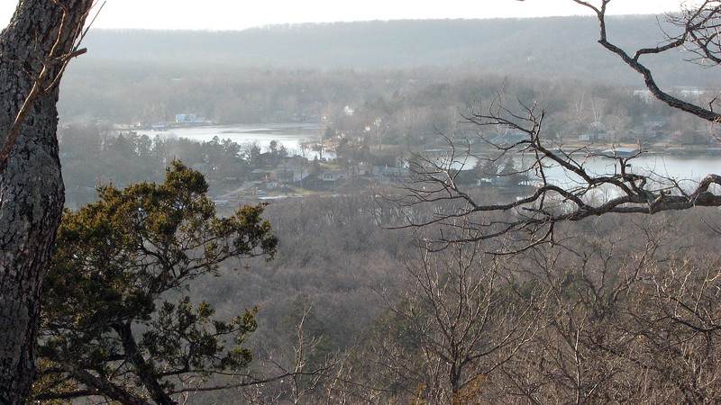 The Lake of the Ozarks is not a US Army Corps of Engineers lake.  This means that private development along the shore is allowed.