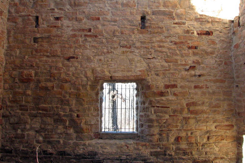 The inside of the building is not open to the public.  You can, however, stick your camera through the bars of the gate in order to snap some photos.  According to the marker, castle staff and their families were housed in quarters below the water tank.