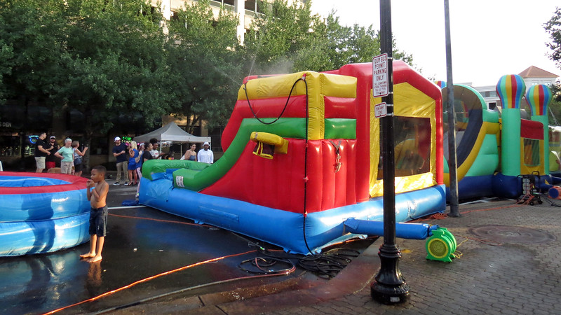The kids area had bounce houses and water slides, great ways to cool off.