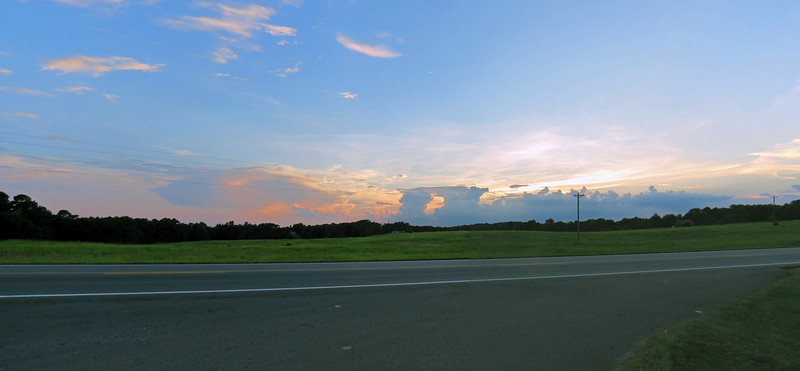 Two-picture panorama of the clouds and sunset along US Route 441.