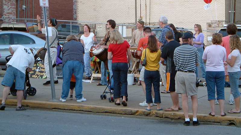 A percussion group along Walnut Street.