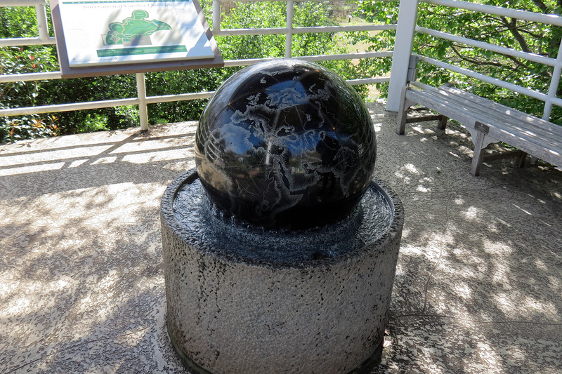 One of the walkways from the Visitor Center to the gardens features a floating globe.  The globe floats on the water beneath it and can be spun and rotated.