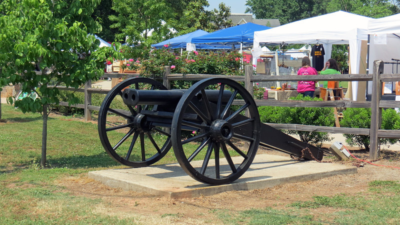 Once past the food vendors, we crossed over Church Street and headed toward Pittard Park.  The cannon in the photo above sits at the park's entrance.  <br /> <br /> This double-barrel cannon is a replica of an actual Civil War cannon that was forged in 1862 and currently sits next to City Hall in Athens.  The replica's date of construction is unknown.  But the builder was David Johnson, father-in-law of the late Wesley Whitehead, a long-time mayor of Winterville.