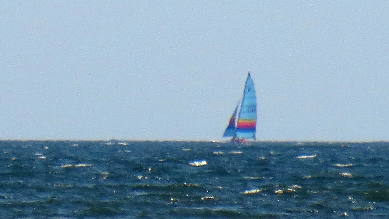 A sailboat off in the distance.