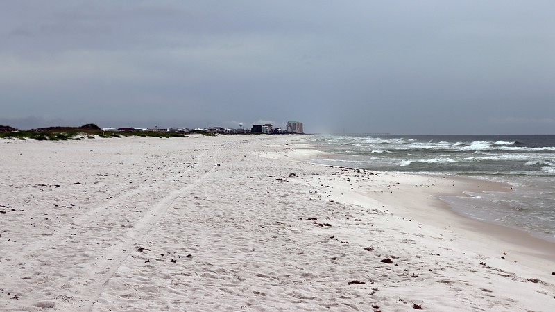 The photo above looks east toward Navarre Beach, the area I passed through to get here.  The tall buildings that come into view in the distance are the large condo complexes next to the Navarre Beach Fishing Pier.
