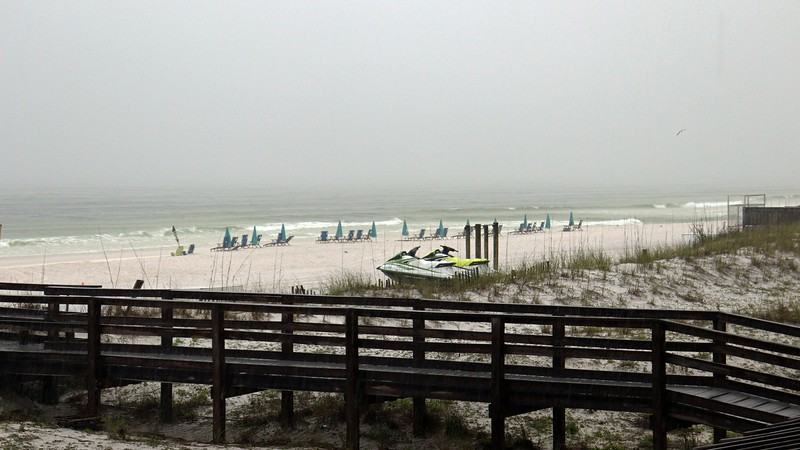 All of the rental chairs and umbrellas were still out on the beach at the Holiday Inn next door, even though the beach was empty.
