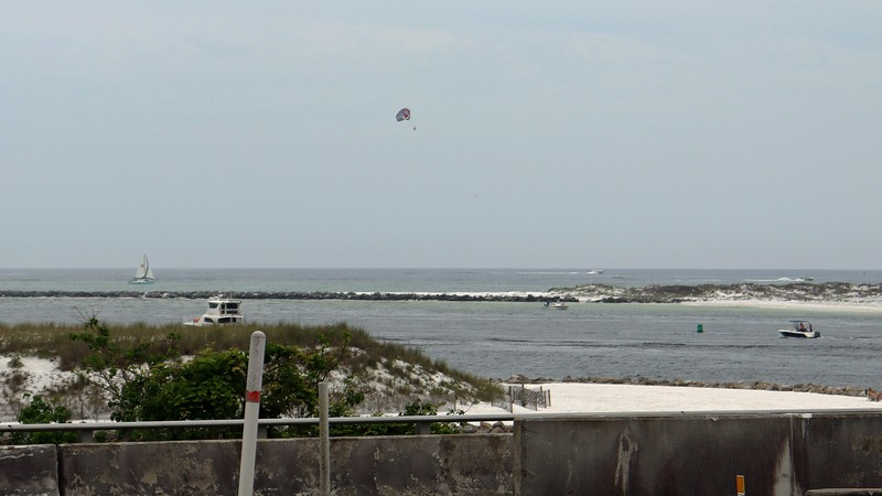 This area is known as East Pass, the waterway that connects the Gulf of Mexico to Choctawhatchee Bay and nearby Destin Harbor, (out of view to the left in the photo above).