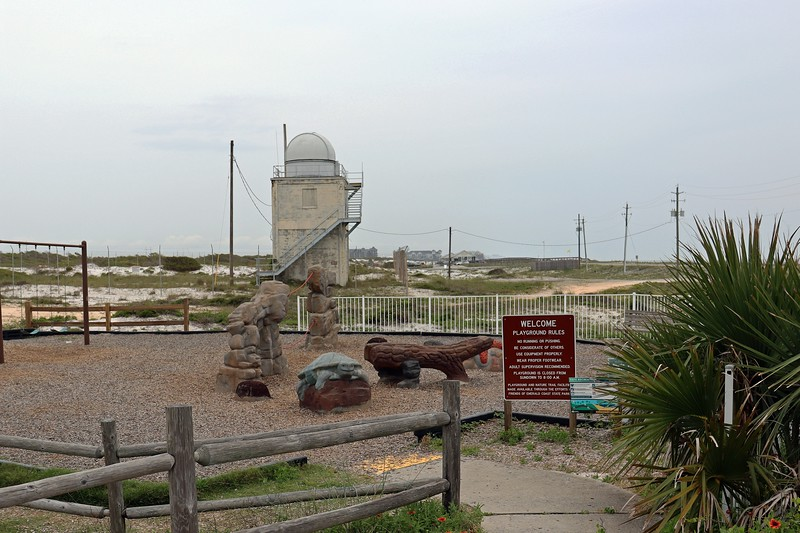 Behind the numerous picnic pavilions, I passed a playground and what looks like a small observatory.