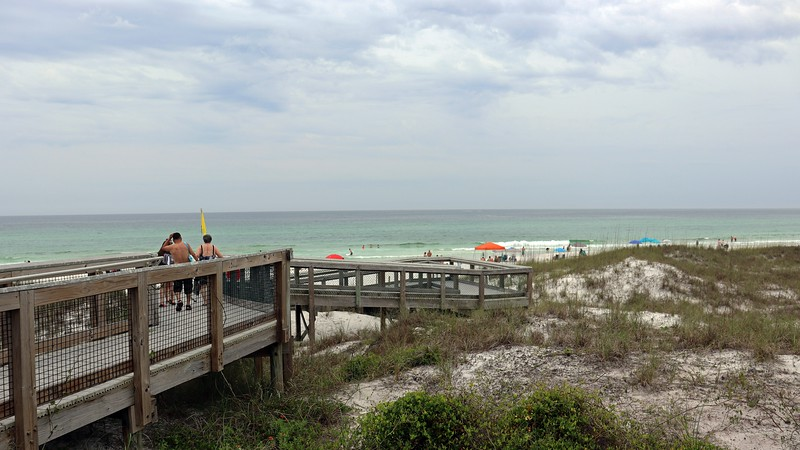 Beach access boardwalks are scattered throughout.