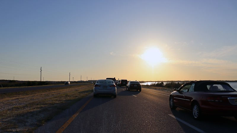 This would be a good sundown picture if all the cars were gone.