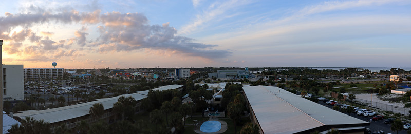 Three-picture panorama of Okaloosa Island as seen from the sixth floor walkway of the Four Points Hotel.