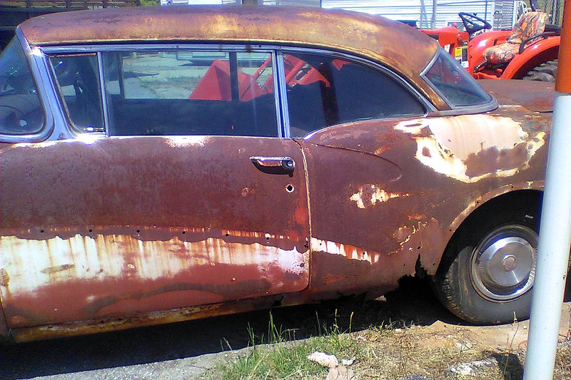 Like the Chevrolet pickup, this car looks like it's been sitting for a while.  Surface rust is plentiful.  But the area in front of the rear wheel in the photo above is actually completely rusted through.