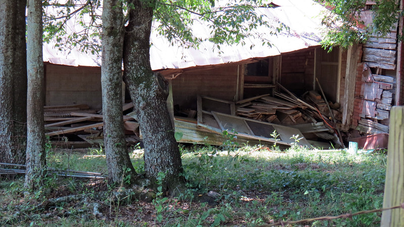 Not only has the front porch roof collapsed, it looks like this entire side of the house is leaning.