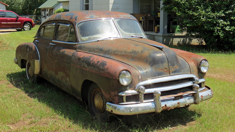 While seeing cars parked in yards is common in rural America, this 1950 Chevy doesn't look like it's been there too long.