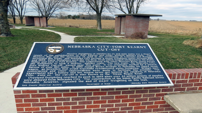 The marker above describes the history of the Nebraska City - Fort Kearny area as a significant trade route in the 1850s.  Freight traffic was transported over the Ox-Bow trail which was convenient due to its close proximity to the Platte River, (i.e. a good supply of water).  But this route was also somewhat out of the way because of the way the river looped northward toward the Platte Valley before heading south again toward Fort Kearny.  As trade increased, the need for a shorter and quicker route arose which lead to the completion of the Nebraska City-Fort Kearny Cut-Off.  The almost directly east-west route passed near this point.