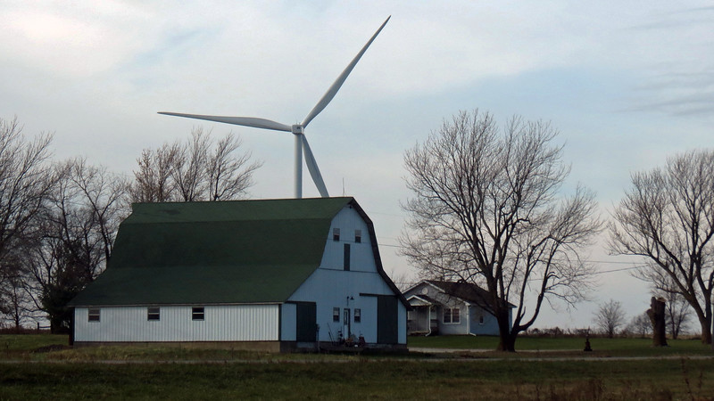 The above photo of a giant wind turbine in the background of a small farm is one of my favorite pics from this day.