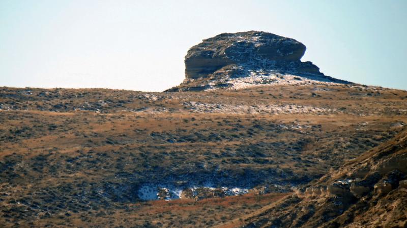 Zooming in on a peak behind Chimney Rock.