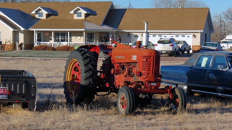 Next to the Frazier was a Farmall tractor.