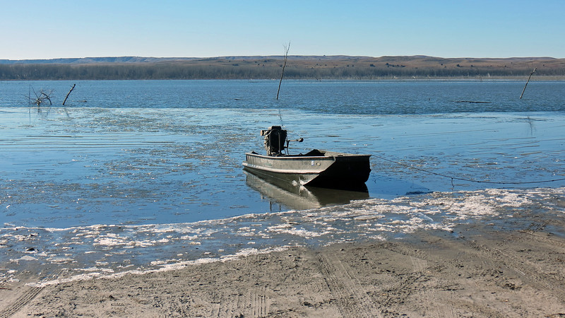 The above photo of a small boat sitting in the partially frozen lake is one of my favorite shots of the day.