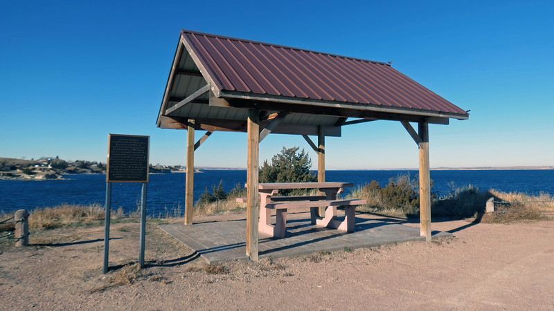 A small pavilion sits at the edge of the parking area.
