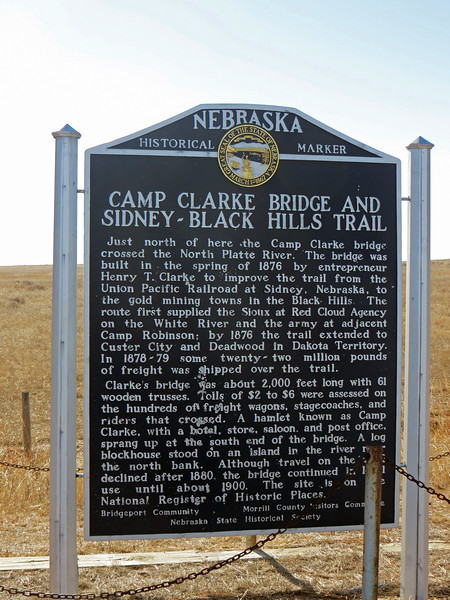 This marker commemorates the Camp Clark Bridge that crossed the nearby North Platte River.  The bridge was part of the Sidney - Black Hills Trail that connected Sidney, Nebraska with the gold mines in the Black Hills of South Dakota.  Built by Henry T. Clarke in 1876, the Bridge's name refers to the town of Camp Clark that was located on the south side of the river.