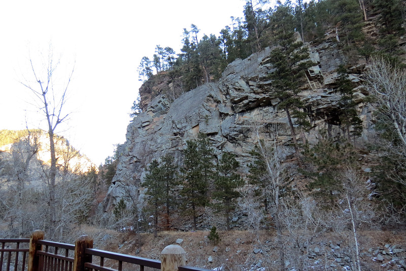I believe the flat section of land at the base of the cliffs is the old railroad bed that operated from 1893 until 1933 when a massive flood damaged the rail line beyond repair.