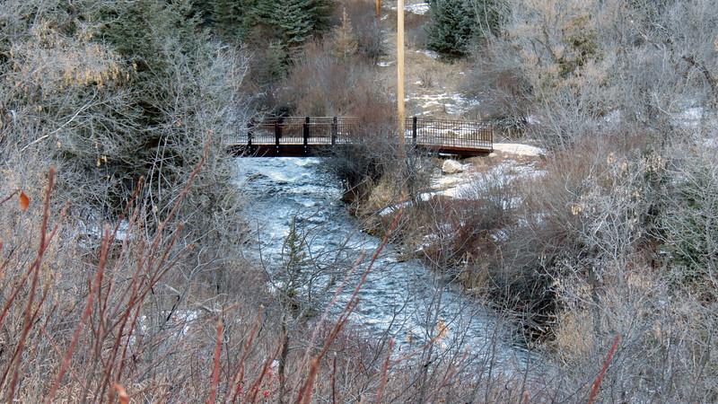 Spearfish Falls Trail bridge over Spearfish Creek.