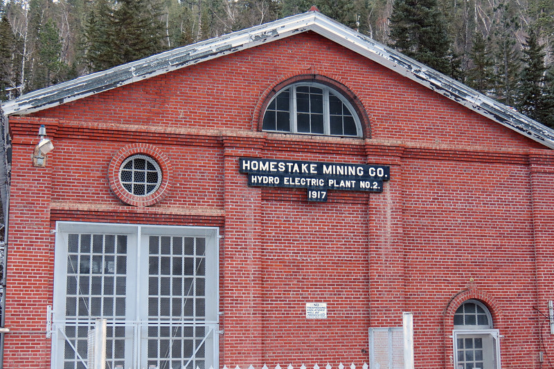 The Homestake Mining Company was a large gold mining operation that existed from 1879 through 2001 when it was merged into the Barrick Gold Corp. of Canada.  It's known for being the second largest gold producer  and for being the longest continually operating mine in the US.  Two hydroelectric power plants were built specifically to supply power to the mines - Plant #1 in 1910 and Plant #2 seen above in 1917.