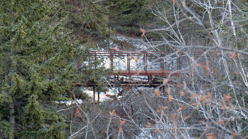 Spearfish Falls Trail bridge across Spearfish Creek.