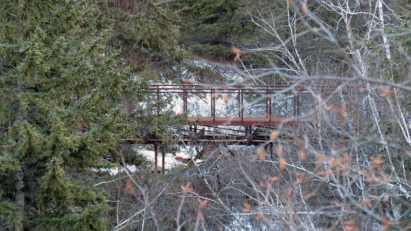 Spearfish Falls Trail bridge across Spearfish Creek.