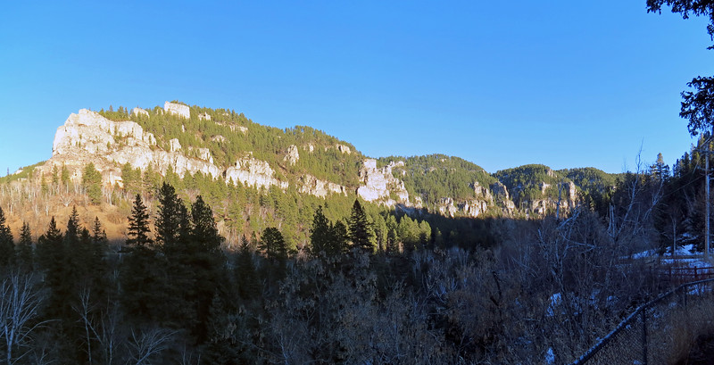 A two-picture panorama of the cliffs seen to the east.