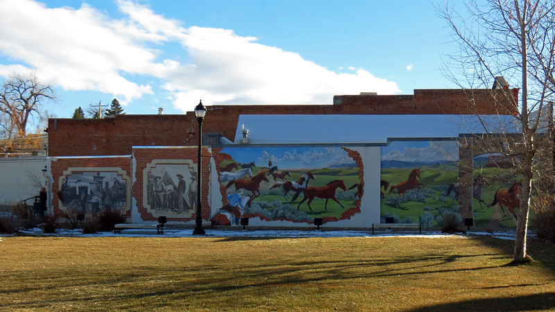 Another large wall mural has been painted on the side of the Hitching Post Art Gallery next to Crazy Woman Square.