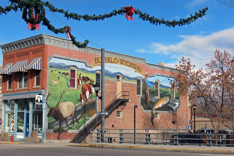 Large mural painted on the side of the Margo's Pottery building.