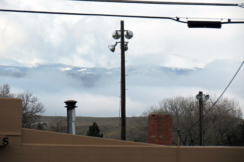 I tried zooming in through the clouds.  I believe I am looking at North Ridge (6,803 feet).