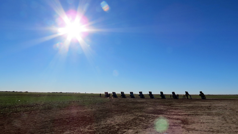 In 1997 when the ever-expanding city of Amarillo started to get too close to the Cadillac Ranch, everything was moved two miles west to its current location, (a cow pasture also owned by Marsh).