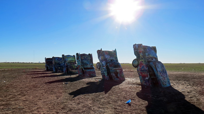 The Cadillac Ranch attracts visitors from all over the world armed with cans of spray paint and ready to leave their mark at the site.
