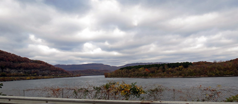 The Tennessee River runs past the base of the mountain.