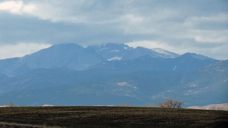 Zooming in on the Twin Sisters Peaks (consisting of Twin Sisters Mountain (11,384 ft), Twin Sisters Peaks East (11,428 ft), and Twin Sisters Peaks West (11,413 ft)), with Long's Peak (14,255 ft) in the background.